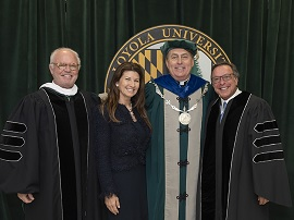 From left to right: Jim Forbes, '90, chairman of the Board of Trustees; Constance Fernandez; President Rev. Brian Linnane, S.J.; and Mike Fernandez