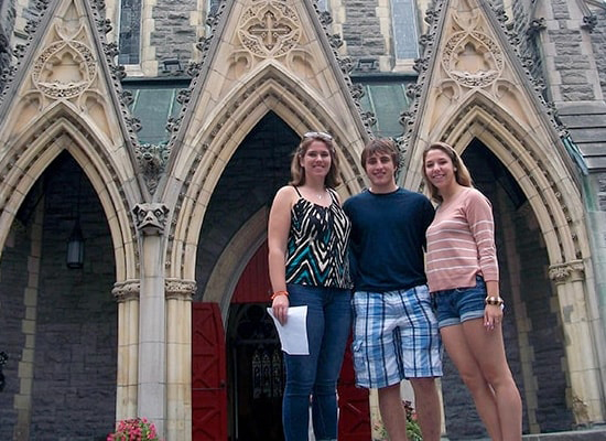 Loyola students pose in front of Christ Church Cathedral in downtown Montreal