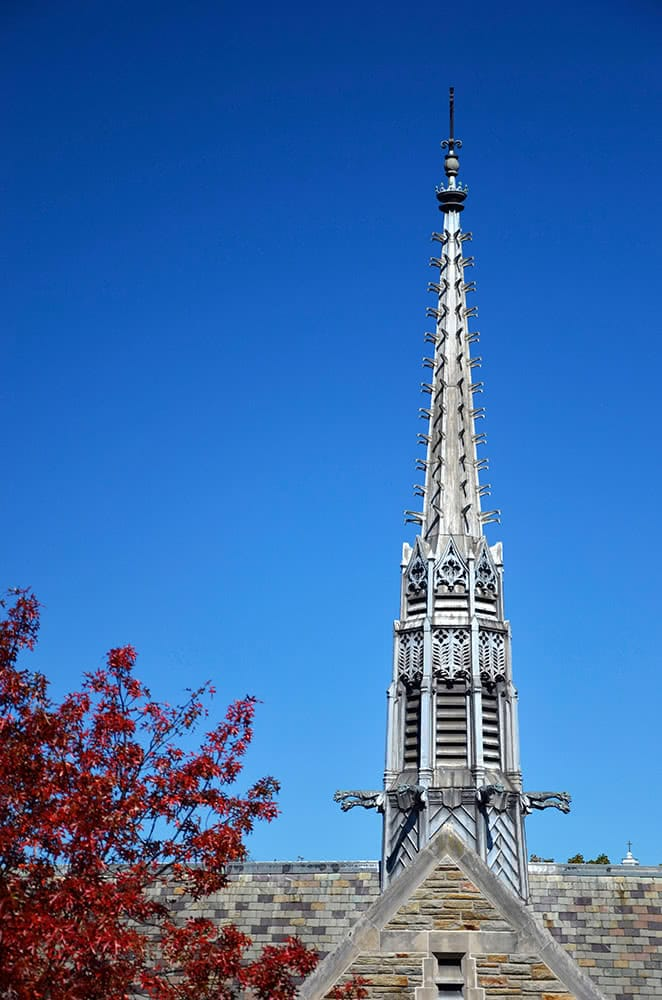 The Alumni Chapel steeple set next to red fall foliage