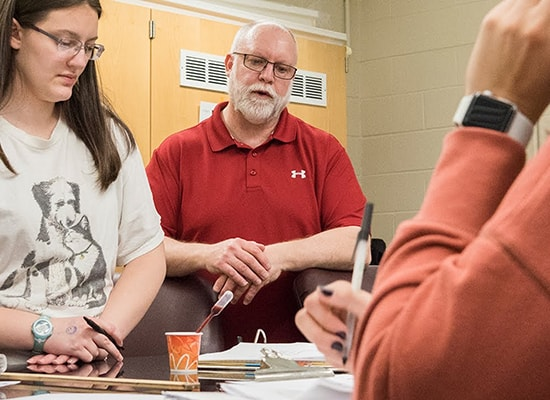 Student and forensics professor reviewing an experiment