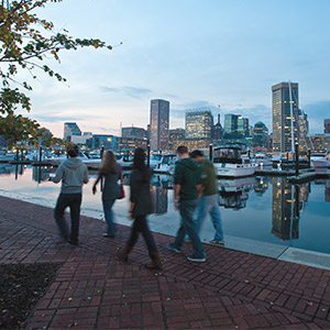 Students walking along the bay in downtown Baltimore