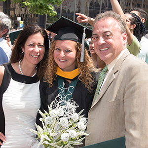 Parents with their daughter at graduation