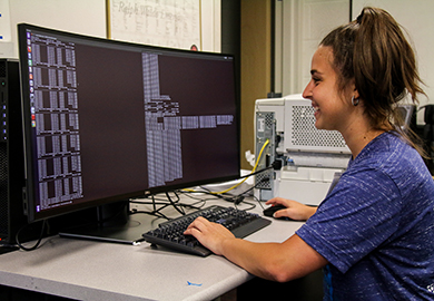 Female computer science student working at computer