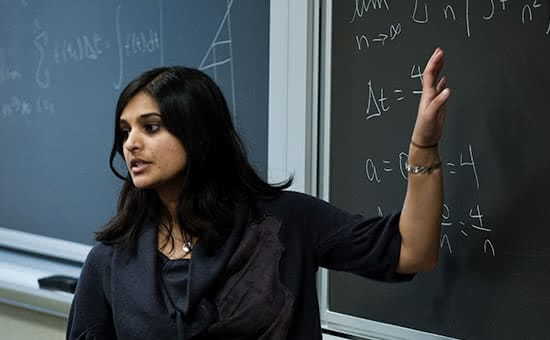 A math professor teaching in front of a blackboard