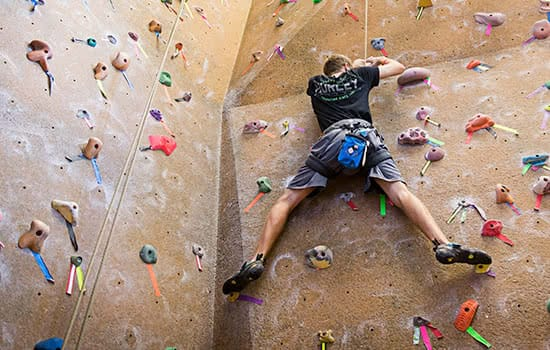 A student climing the rockwall