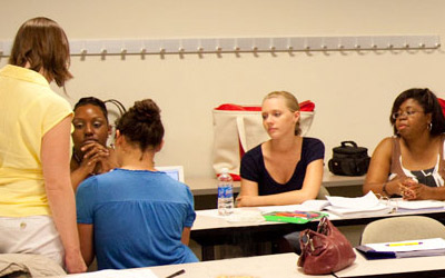 Graduate students learning in a classroom