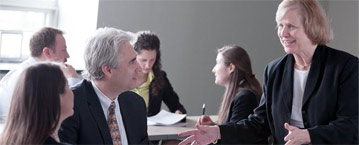 Executive students having a discussion in the classroom